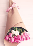 Pink and white tulips over wood Stock Photo