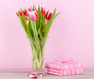 Pink and white tulips present ribbon easter birthday Royalty Free Stock Image