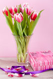 Pink and white tulips present ribbon easter birthday Stock Photo