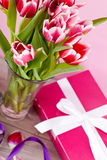 Pink and white tulips present ribbon easter birthday Royalty Free Stock Photography