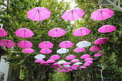 Pink and white umbrellas decorate streets in  Bellaria Igea Marina Royalty Free Stock Photos