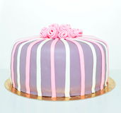Pink, white and violet roses fondant cake. Birthday fondant cake with stripes and roses royalty free stock images