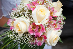 Pink and white wedding bouquet of roses. Beautiful pink and white wedding bouquet of roses Stock Image