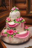 Pink and white wedding cake on a dessert table Royalty Free Stock Image