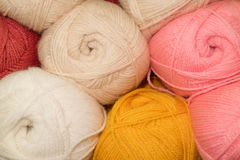 Pink and white wool. Many woolen yarn pink and white, soft rich texture royalty free stock images
