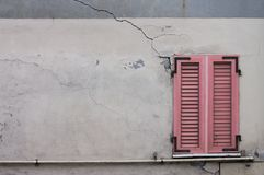 Pink window of a ruined house. Pesaro, Italy Stock Photography