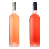 Pink wine bottles on white. Two different pink wine bottles isolated on white with clipping path stock image