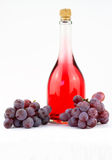 Pink wine and grapes Stock Image