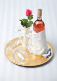 Pink Wine on Tray with Glasses and Rose Stock Image