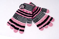 Pink winter gloves stock image