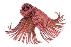 Pink winter scarf with fringe nicely arranged. Royalty Free Stock Photo