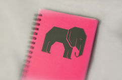 Pink wire binded notebook Stock Photos