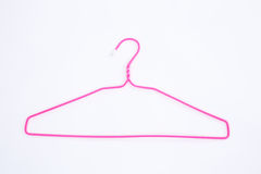 Pink wire hangers on white background stock photo