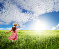 Pink Woman with beautiful blue sky in greenland Royalty Free Stock Image