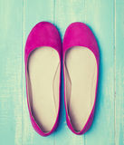 Pink woman shoes on blue colored wooden background Stock Photo