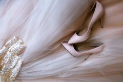 Pink women`s wedding shoes royalty free stock images