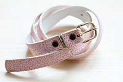 Pink women style belt on a light wooden background Stock Photo