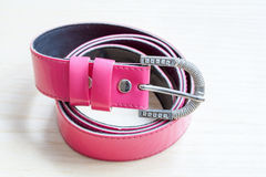 Pink women style belt on wooden background Stock Images