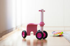 Pink wood bike toy. In the middle of the living room royalty free stock image