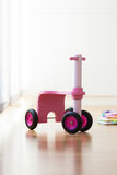 Pink wood bike toy Stock Photo