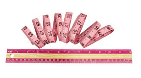 Pink wood and plastic rulers Stock Photos