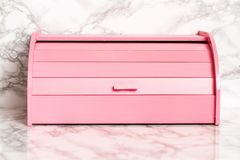 Pink Wooden Bread Box on White Marble Background