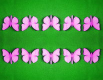 Pink wooden butterflies, wood carving Stock Images
