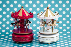 Pink Wooden Carousel Horses with Old Vintage Look. Wooden carousel horses with old vintage look on blue background Stock Images
