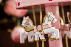 Pink Wooden Carousel Horses with Old Vintage Look Royalty Free Stock Photo