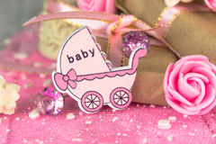 Pink wooden carriage figure with wrapped presents Royalty Free Stock Image