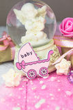 Pink wooden carriage figure with wrapped presents. Girl birth concept Stock Images