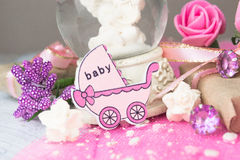 Pink wooden carriage figure with wrapped presents. Girl birth concept Royalty Free Stock Photography