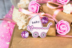 Pink wooden carriage figure with wrapped presents. Girl birth concept Royalty Free Stock Images