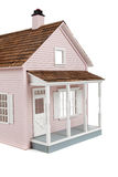 Pink wooden dollhouse on white Royalty Free Stock Photography
