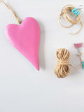 Pink wooden heart Stock Photography