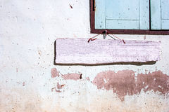 Pink wooden sigh on old cement wall. Pink wooden sigh is on old cement wall Royalty Free Stock Images