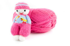 Pink wool ball with selfmade knitted doll Stock Image