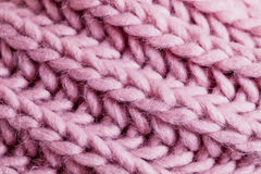 Pink wool. Close up of a knitted wool pattern Stock Photography