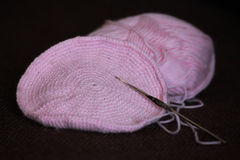 Pink wool with crochet hook Stock Photography