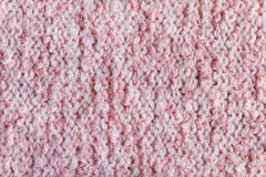 Pink wool knitted background closeup. Pink color wool handmade knitted background closeup Stock Images