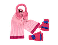 Pink wool scarf, a pair of gloves and earmuffs nicely arranged. Royalty Free Stock Photo