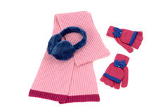 Pink wool scarf, a pair of gloves and earmuffs nicely arranged. Stock Photos