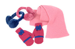 Pink wool scarf, a pair of gloves and earmuffs nicely arranged. Royalty Free Stock Image