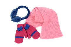Pink wool scarf, a pair of gloves and earmuffs nicely arranged. Royalty Free Stock Photography