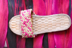 Pink wooven slippers over the textures Stock Photography