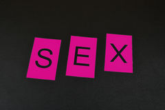 Pink word `Sex` on the black background. Word from isolated letters. Pink word `Sex` on black background. Word from isolated letters. Pink letters for word Sex Royalty Free Stock Images