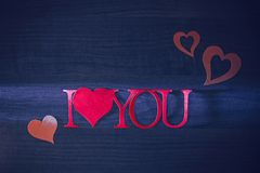 Pink words i love you on a blue background royalty free stock photo