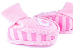 Pink woven baby shoes on white Royalty Free Stock Photo