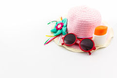 Pink woven hat with body lotion and red sunglasses. Royalty Free Stock Photos