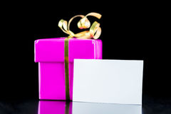 Pink wrapped gift with blank card Royalty Free Stock Images